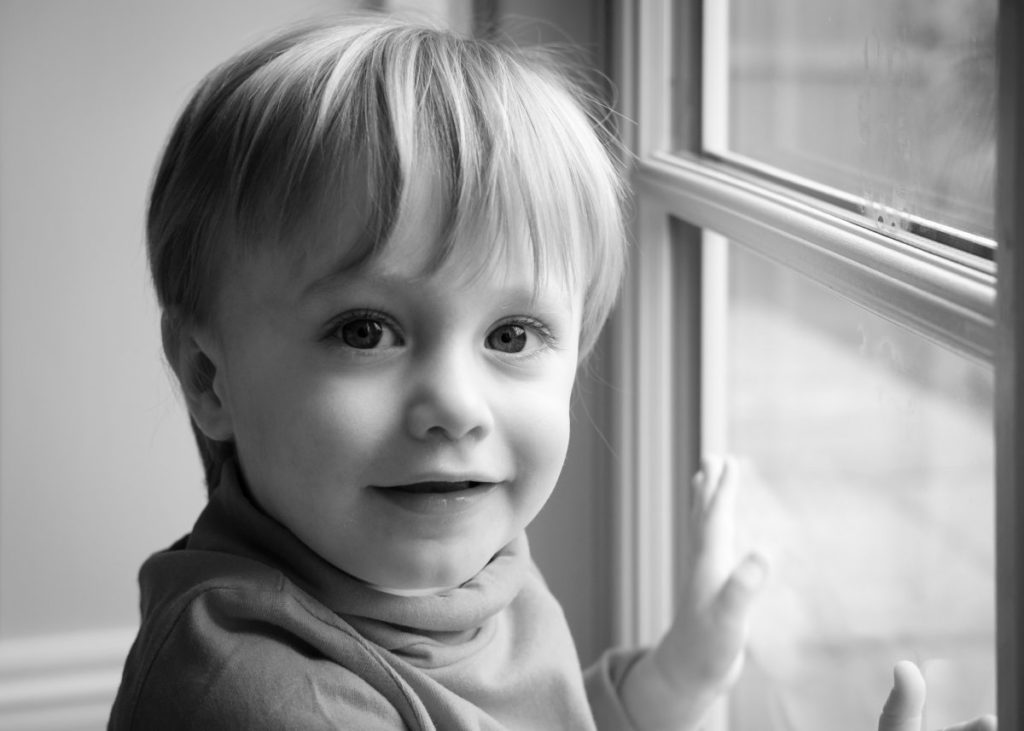 Portrait of young boy with window light