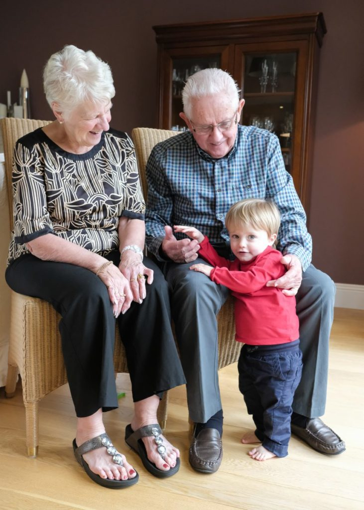 Family portrait of grandparents with their grandson
