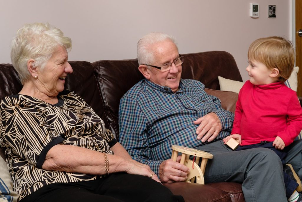 Grandparents having fun and playing with their grandson