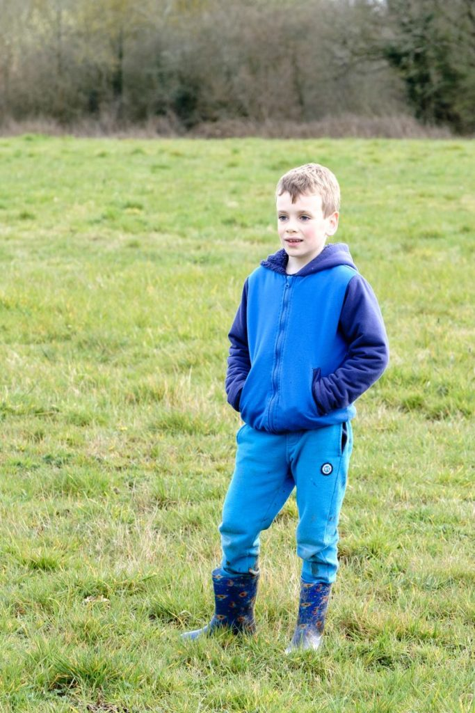Portrait of young boy enjoying open space at Southwick Country Park