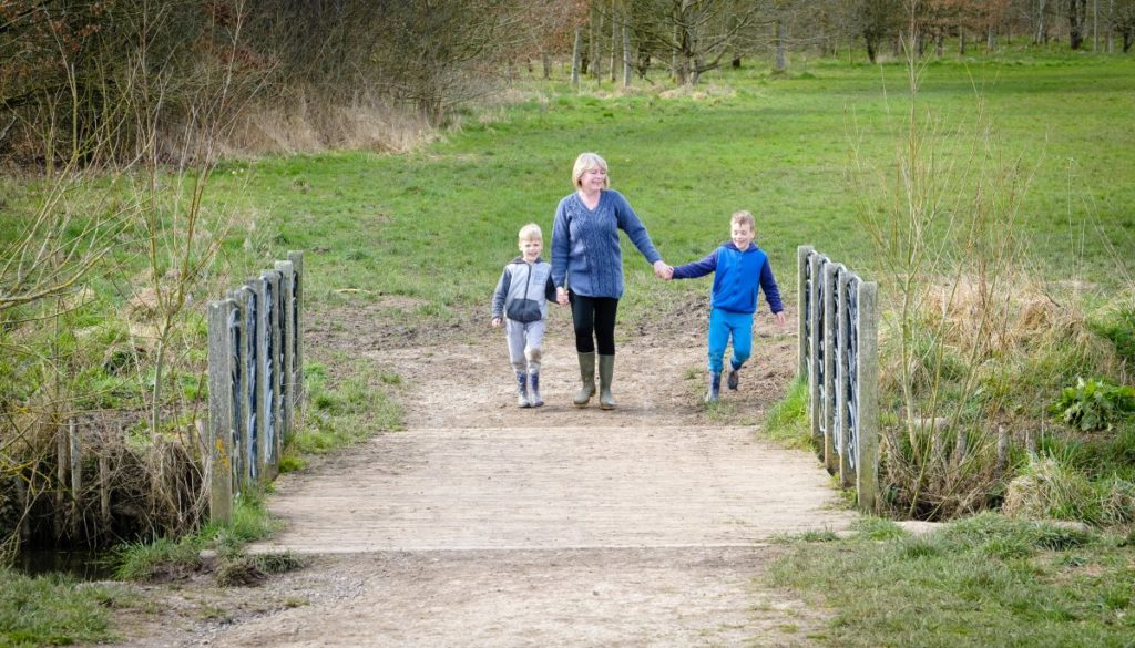 Mum and young boys enjoying a spring walk at Southwick Country Park