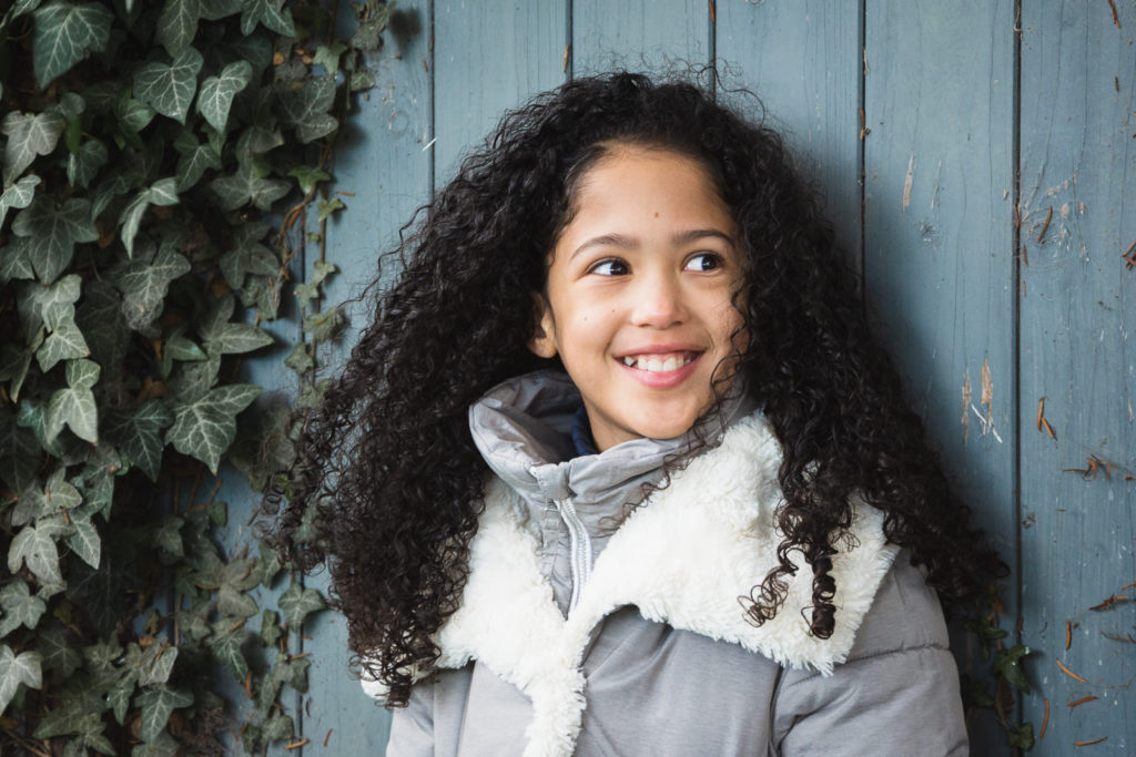 Family photography with teenage girl wearing grey winter coat