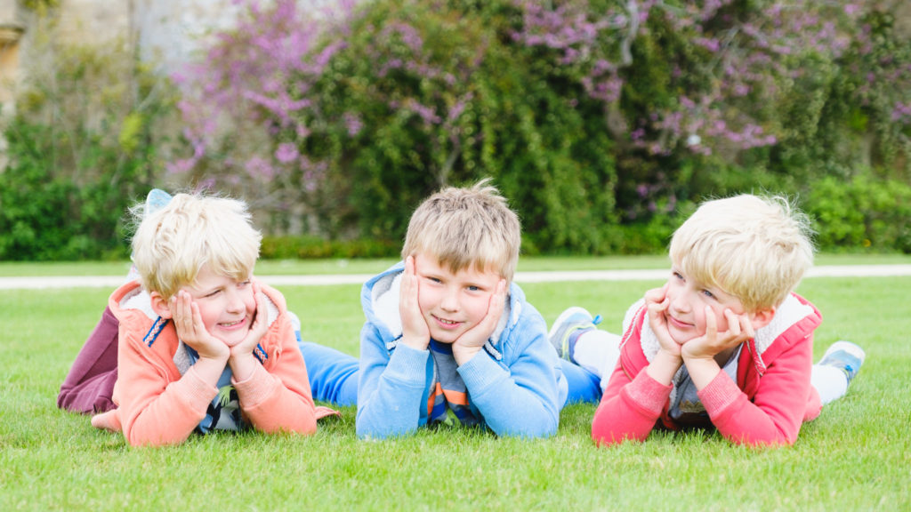 Family photography - three boys in colourful clothes in Lacock Wiltshire