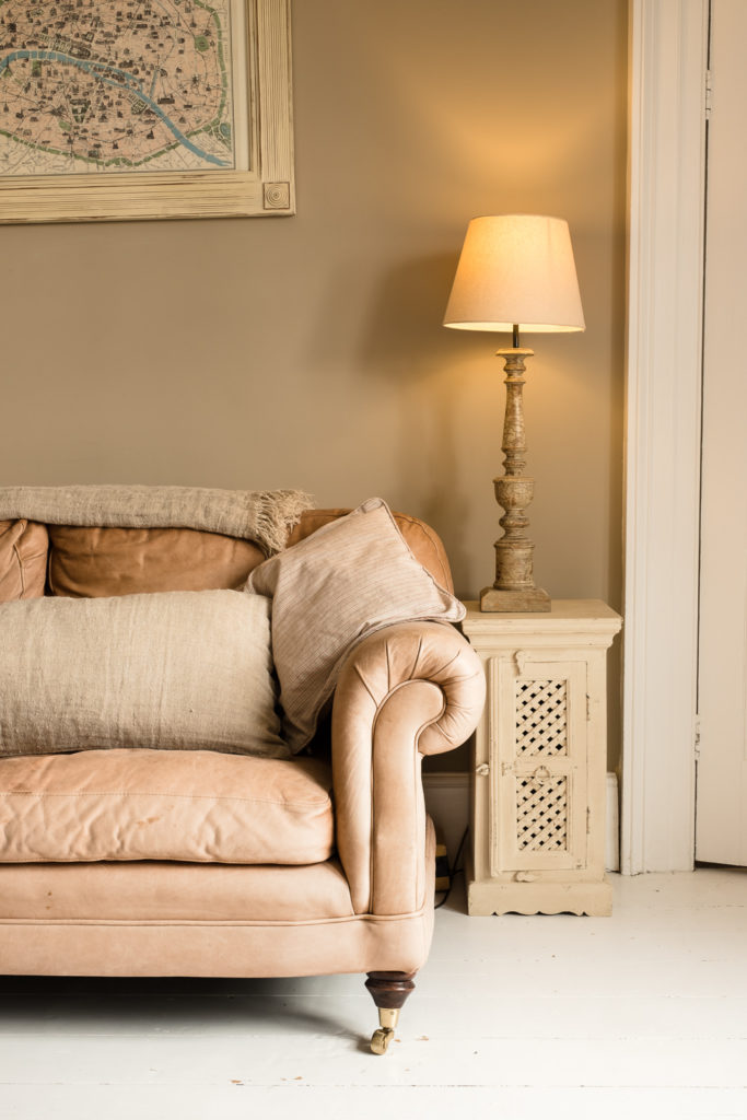 Corporate marketing photography with image showing partial view of a classically designed settee in farmhouse lounge