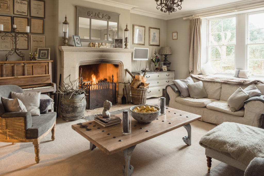 Corporate marketing photography with image showing cosy farmhouse lounge with open fire
