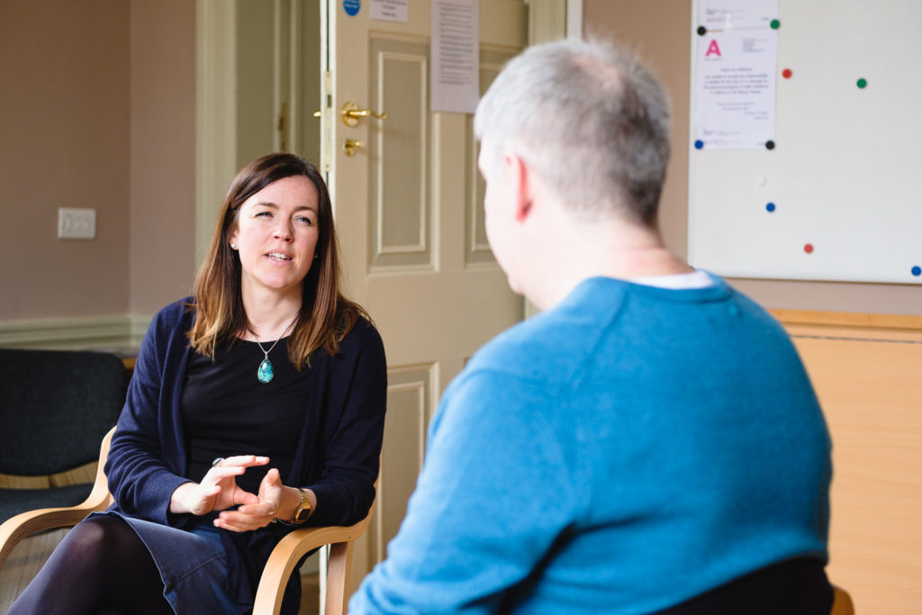 Corporate marketing photography - image from a series showing a relaxed conversation used in marketing material by charity Action on Addiction