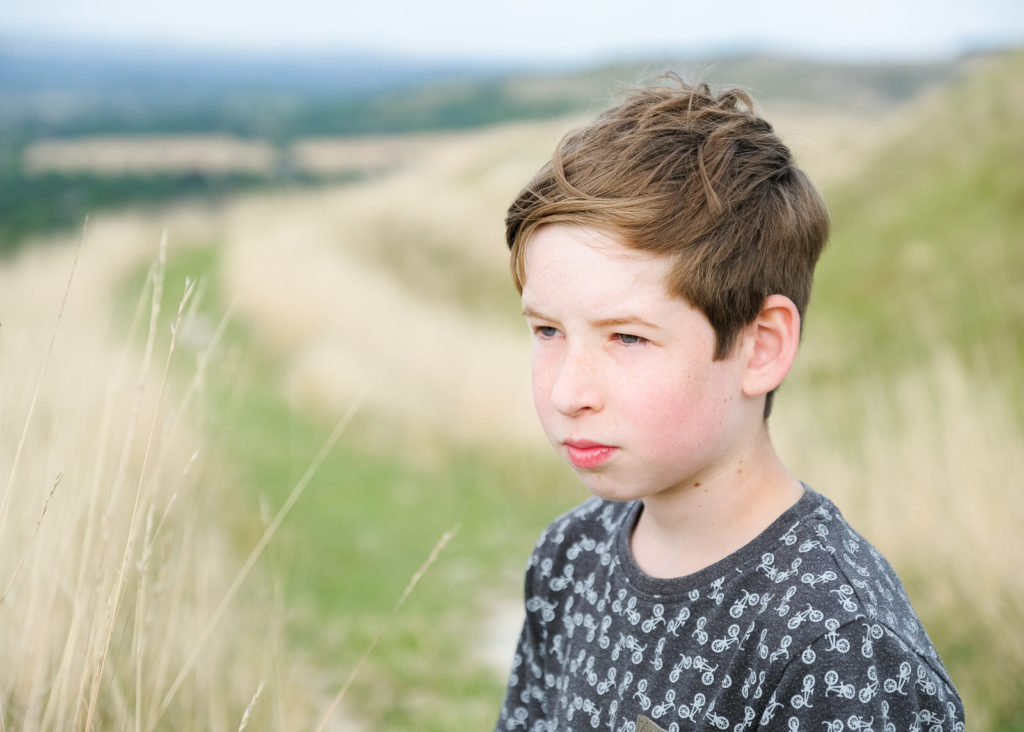 Family photography - teenage boy taking in the view at the Westbury White Horse