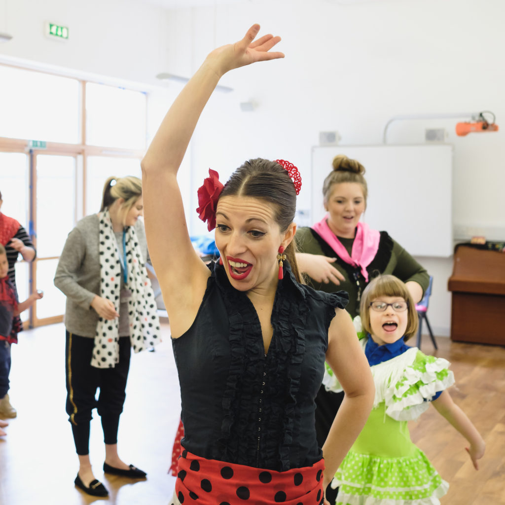 Family photography young children at three ways school in Bath learning Spanish dancing