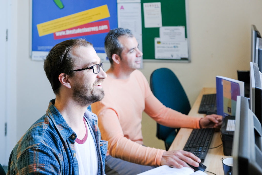 Corporate marketing photography - image from a series with charity action on Addiction showing students researching in the IT suite
