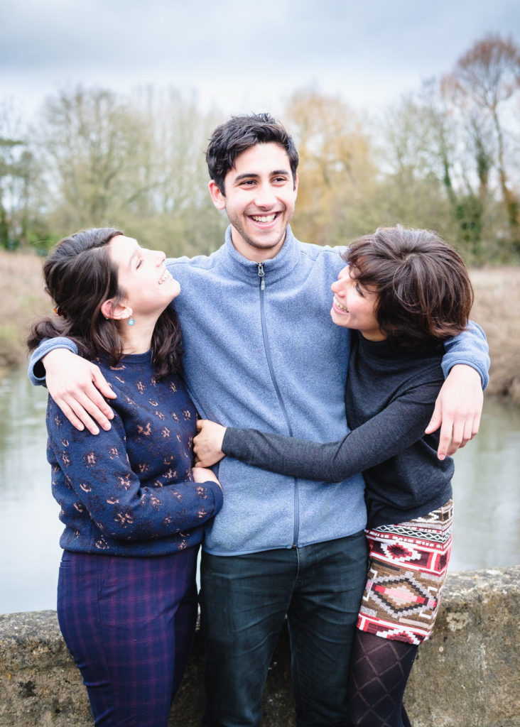Natural light family photography with brother and two sisters in Lacock Wiltshire