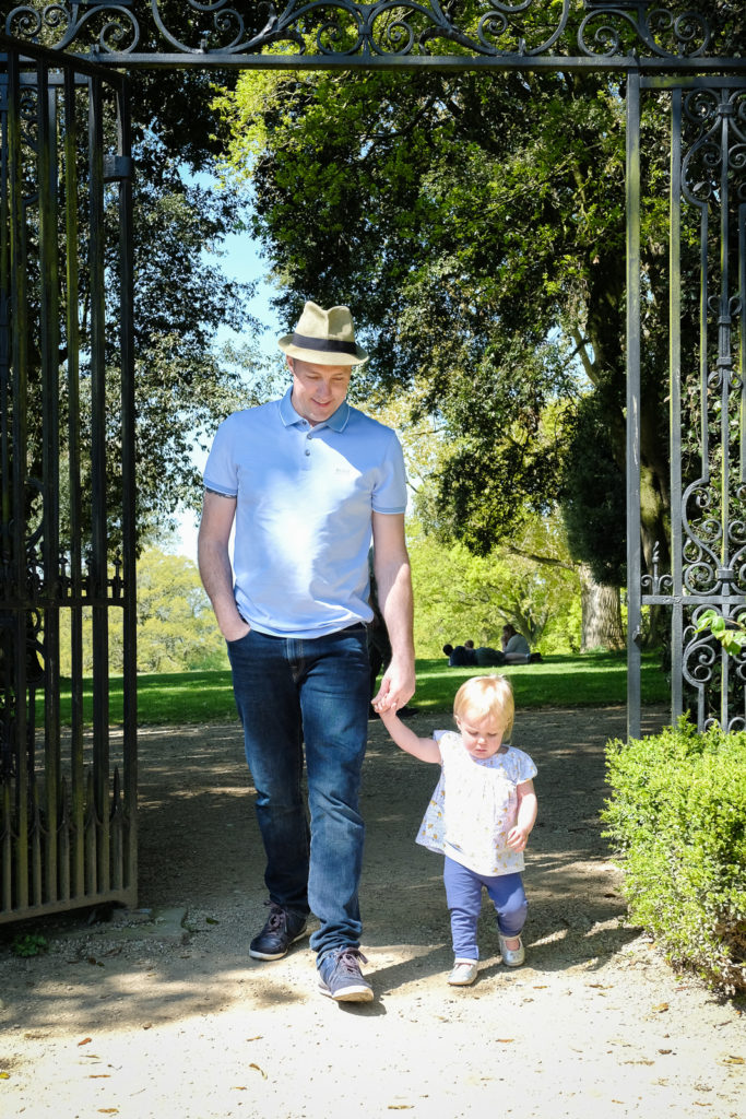 Family photography with dad and daughter enjoying a peaceful moment in country house gardens