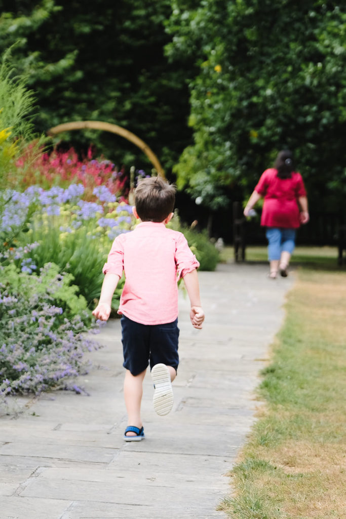 Family photo session - young boy running to mum at Bath Botanical Gardens