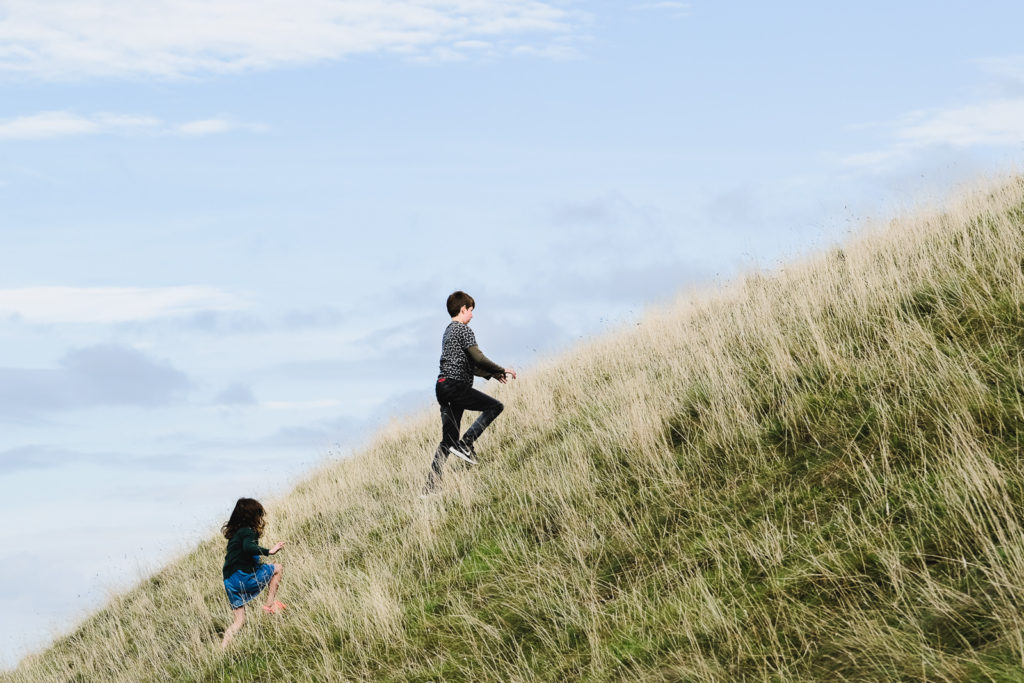 Family photography - young children enjoying the outdoors at the Westbury white horse