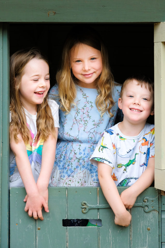 Family photography - children playing in the garden at Cotswold county house