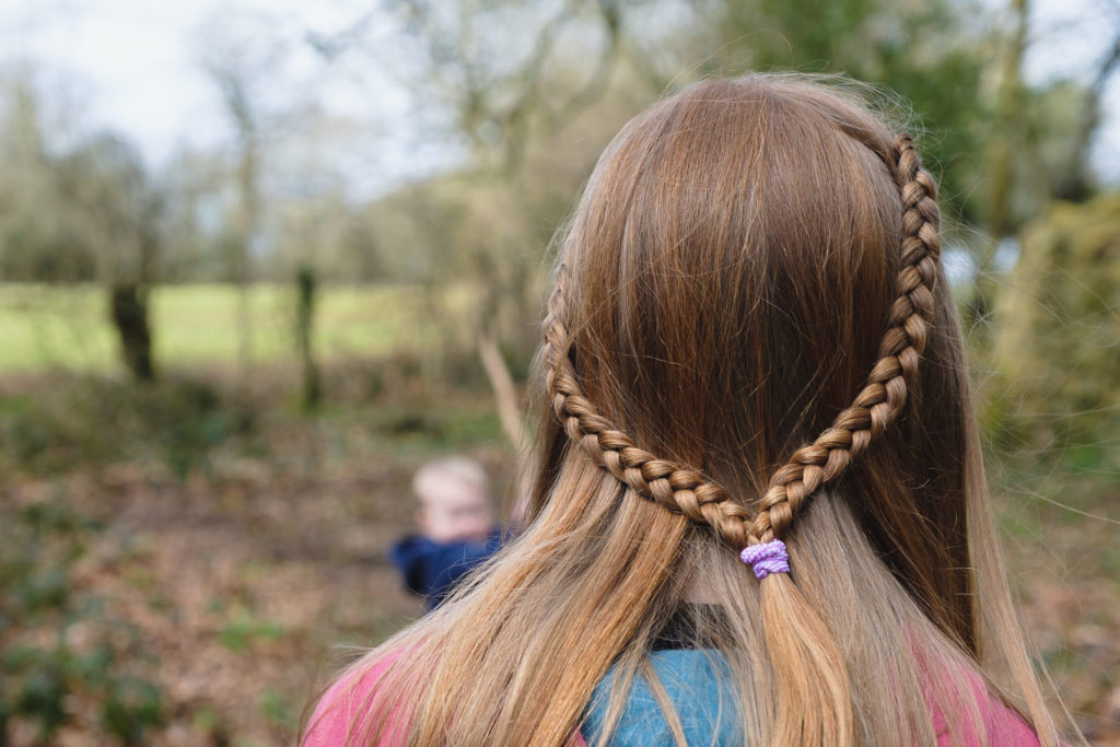 Family photography teenage girl with plaited hair on walk near Bath