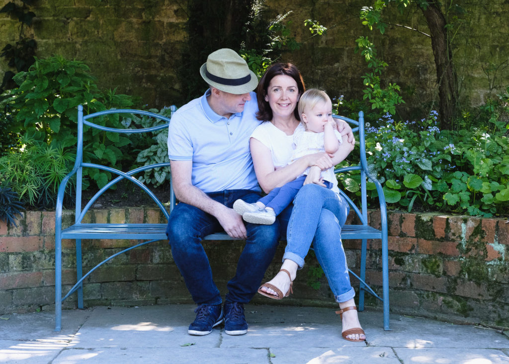 Family photography - enjoying a peaceful moment in country house gardens