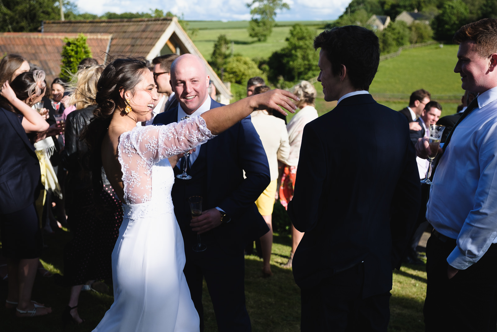 Wedding photography with bride welcoming and embracing a guest
