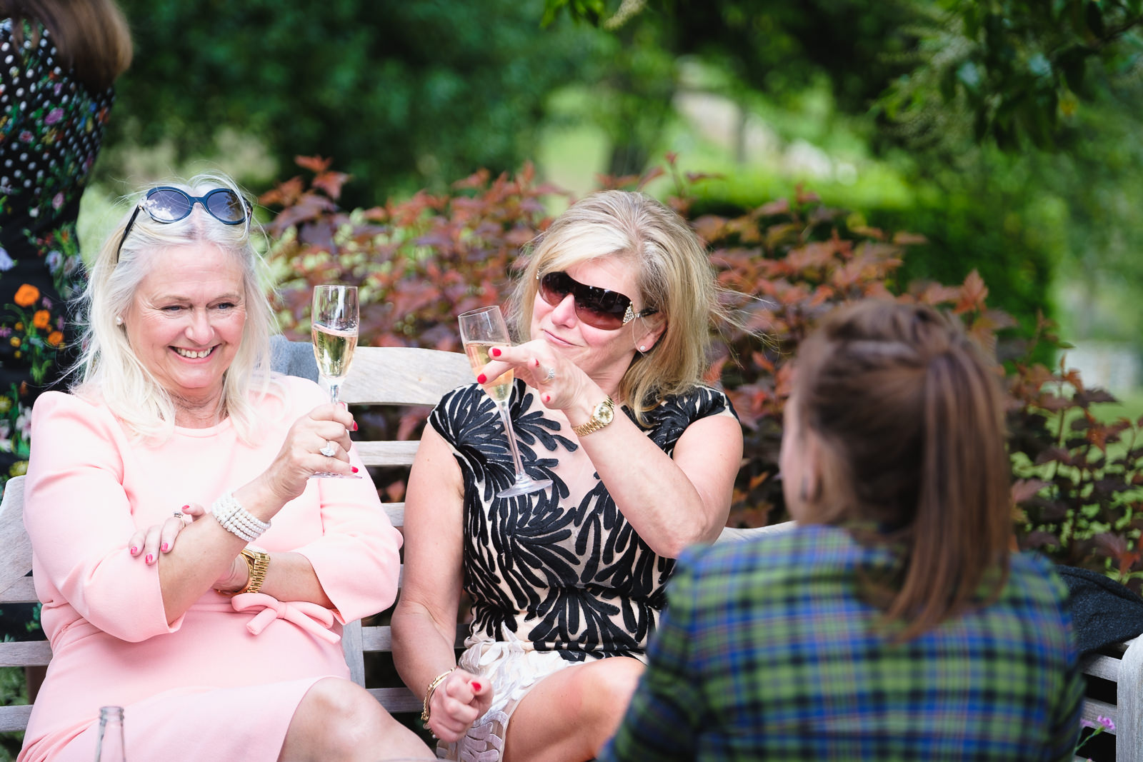 Wedding photography with women having fun and enjoying a glass of champagne