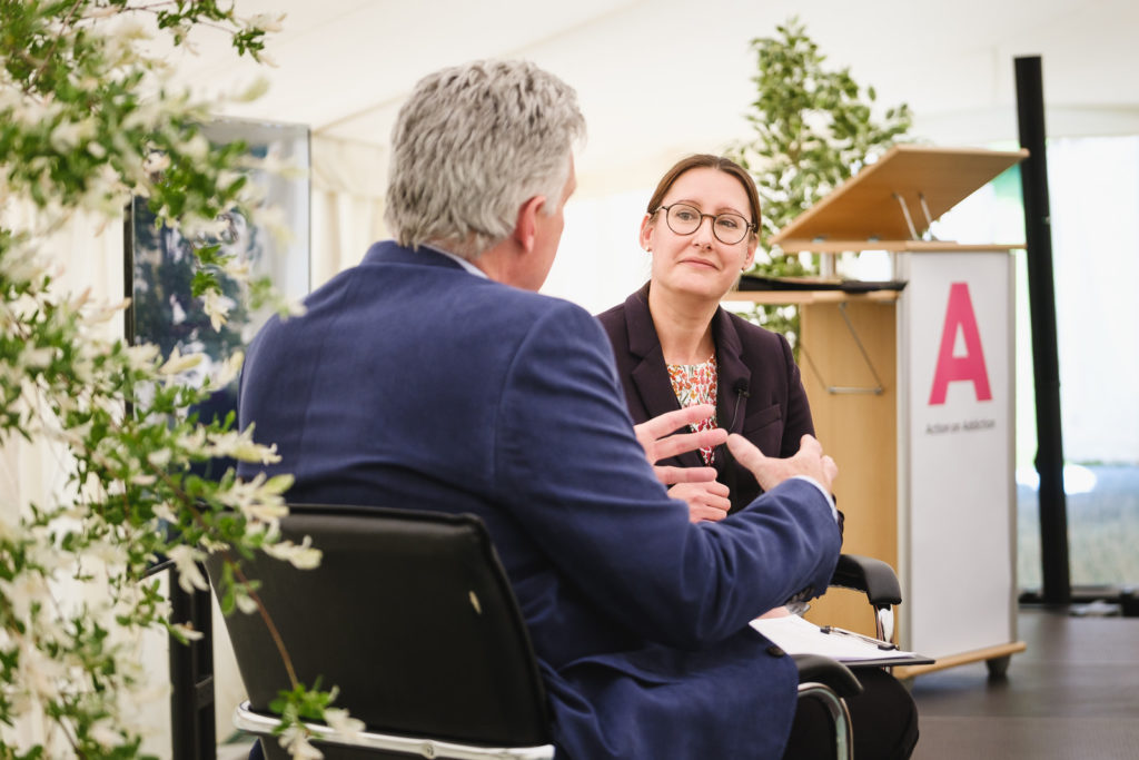 Corporate event photography with members of charity management team taking part in a Q&A at a conference