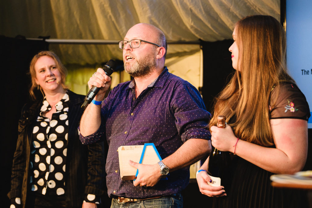 Corporate event photography with winner at Bath Creative Awards making a thank you speech
