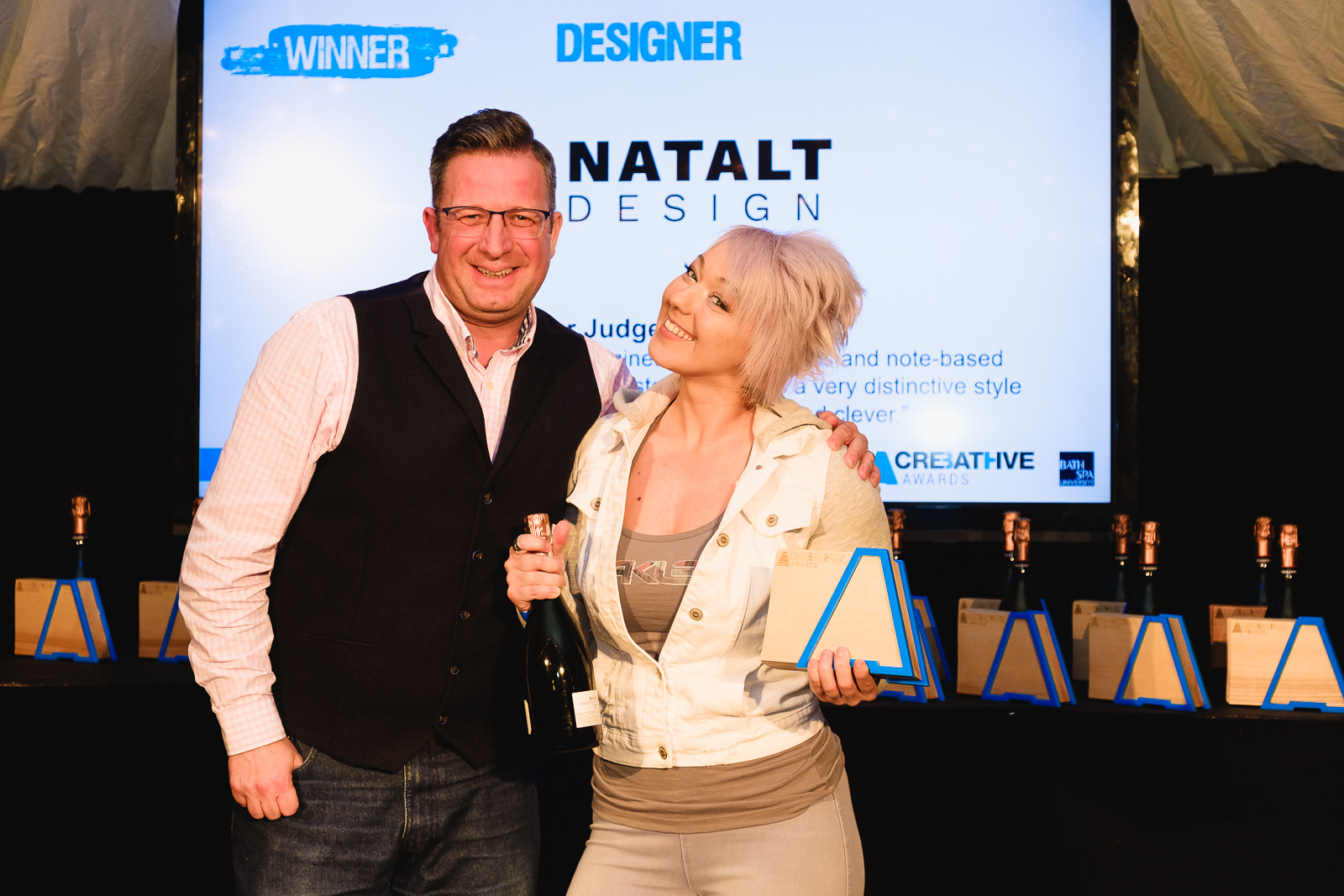 Corporate event photography with winner at Bath Creative Awards receiving award