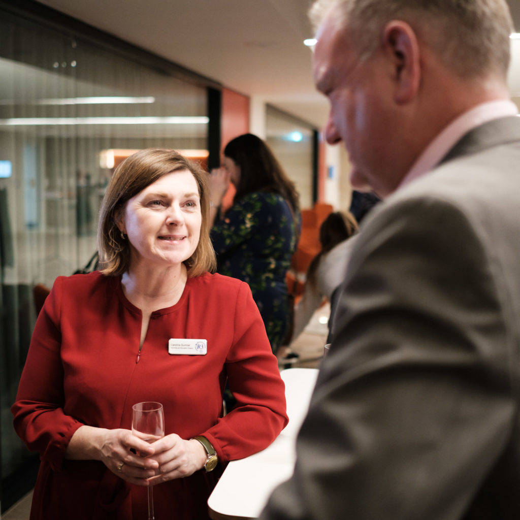 Corporate event photography with group networking at the Apex Hotel in Bath