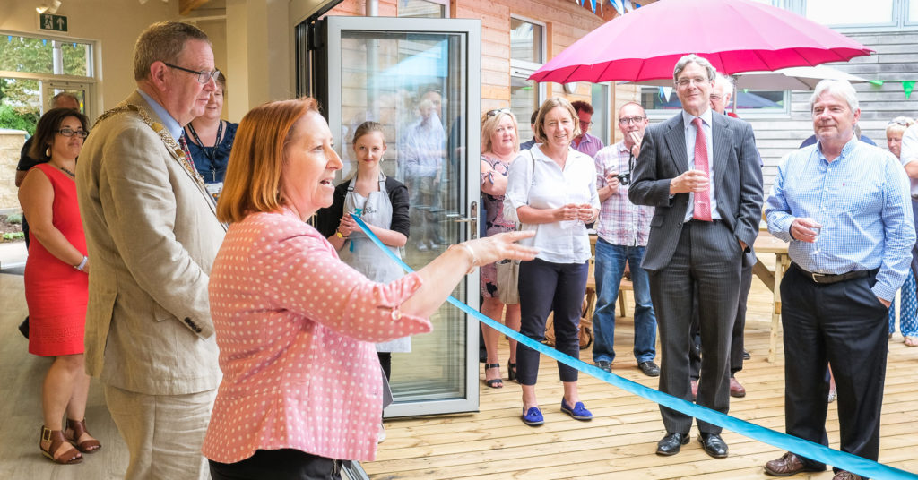 Corporate event photography with head of Three Ways School opening the new Three Ways Cafe in Bath