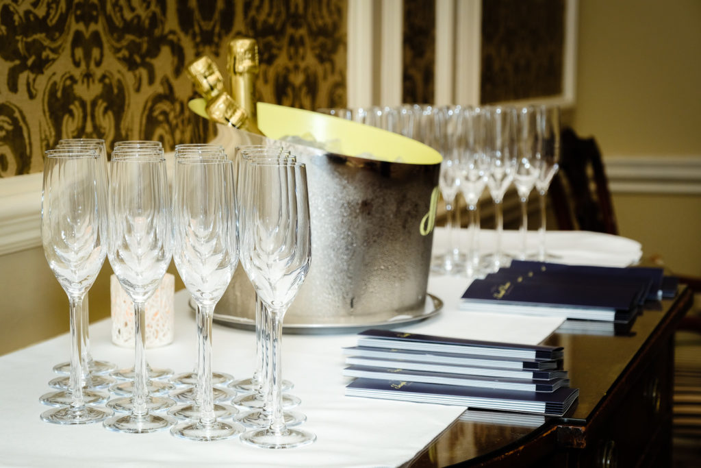 Corporate event photography with champagne ready for guests at Lucknam Park Hotel in Wiltshire