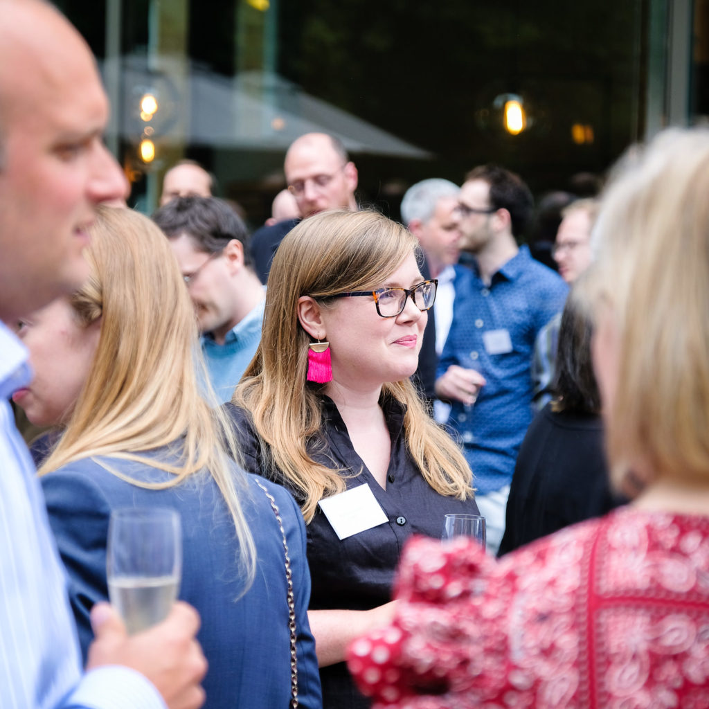 Corporate event photography with group chatting at summer party at Holborn Museum in Bath