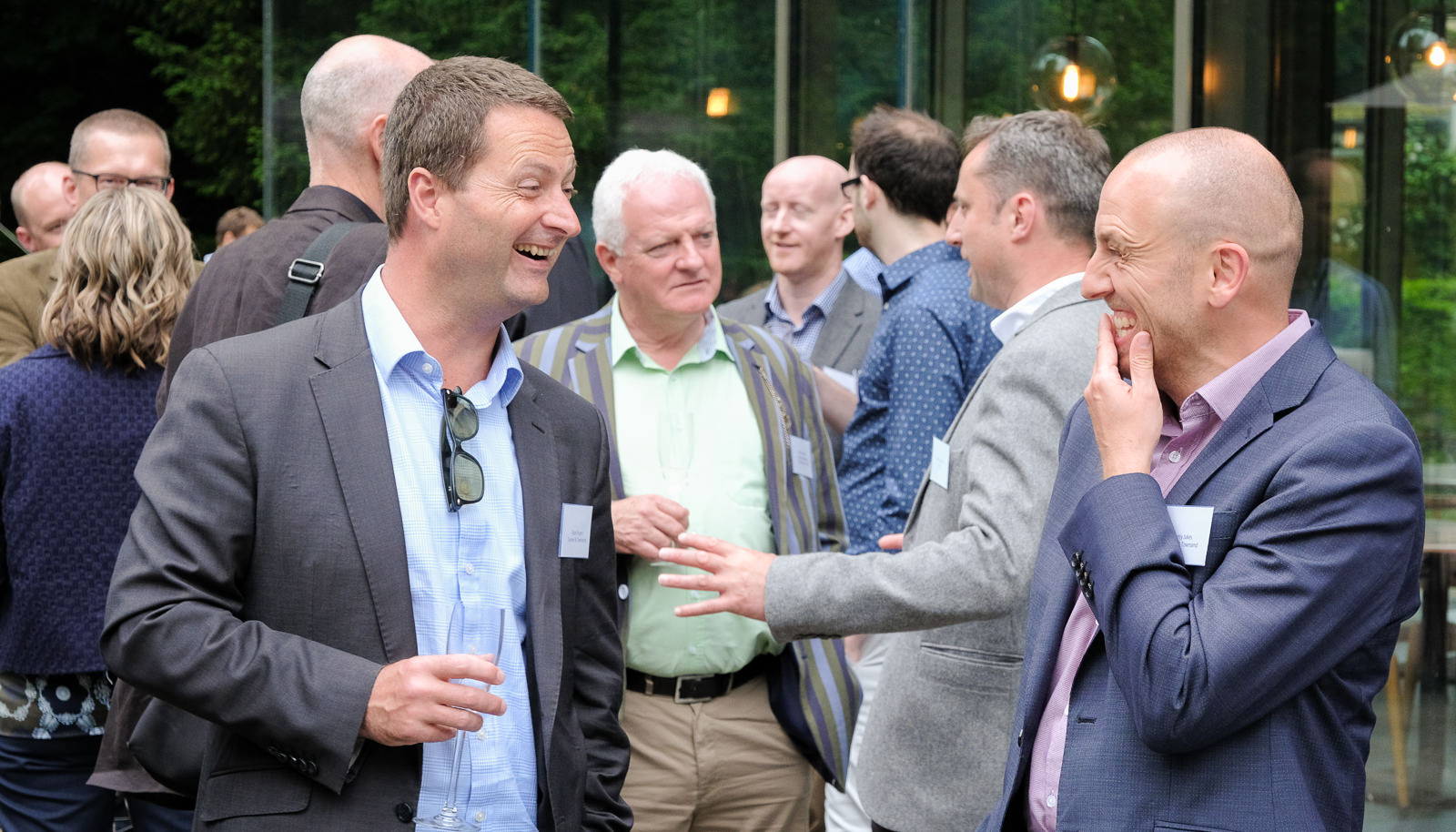 Corporate event photography - men chatting at corporate event at Holborn Museum in Bath