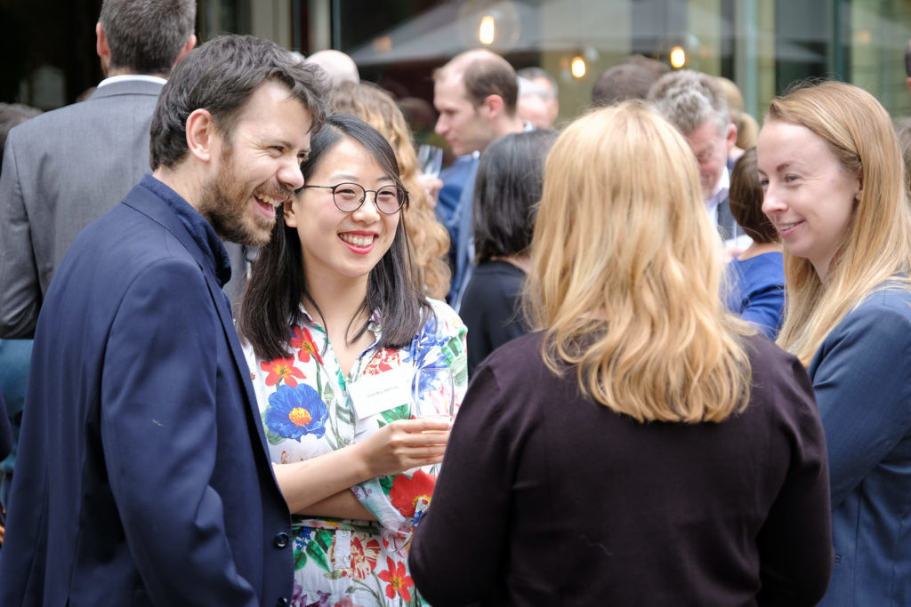 Corporate event photography - group chatting at corporate event at Holborn Museum in Bath
