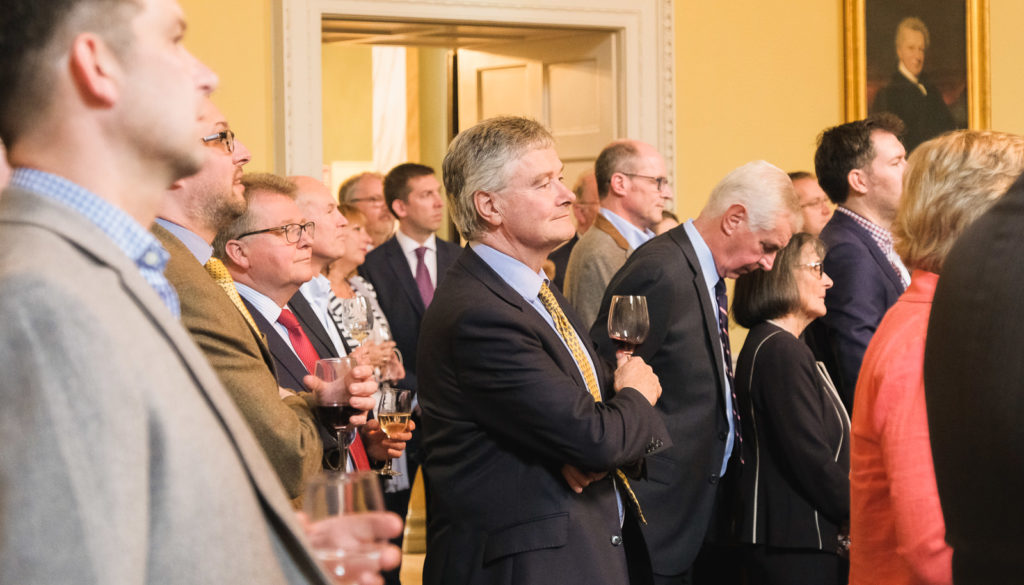 Event photography - group of people listening to leaving speech at Bath Assembly Rooms