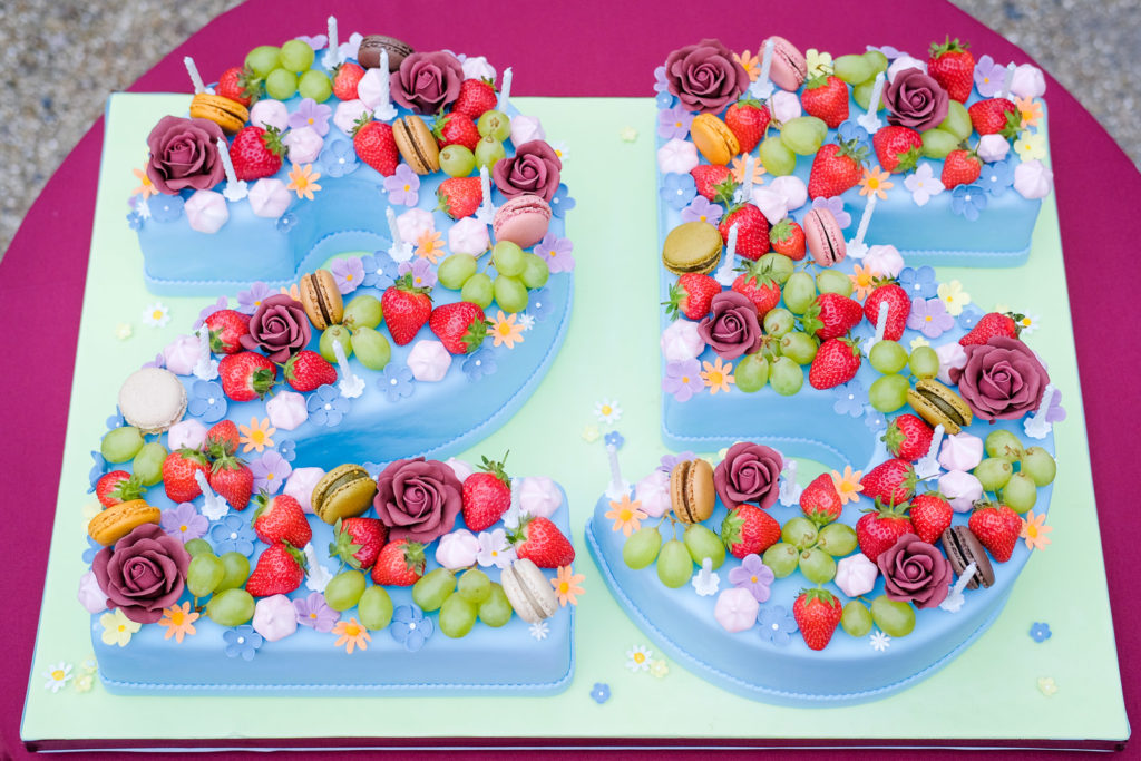 Special occasion family photography - 25th anniversary cake topped with fruit and macaroons