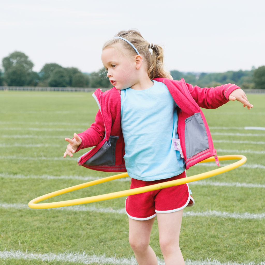 Young girl having fun with a hoola hoop at the Try Games 2019