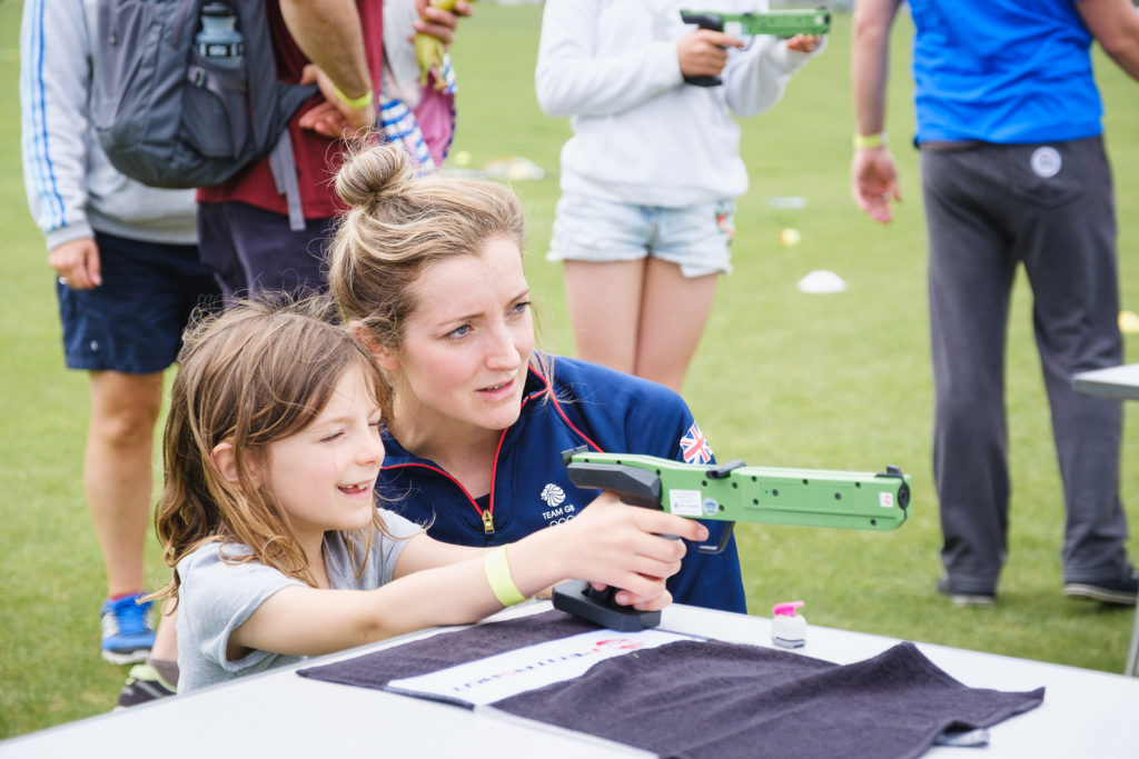 Young girl trying out shooting with Team GB at the Try Games 2019