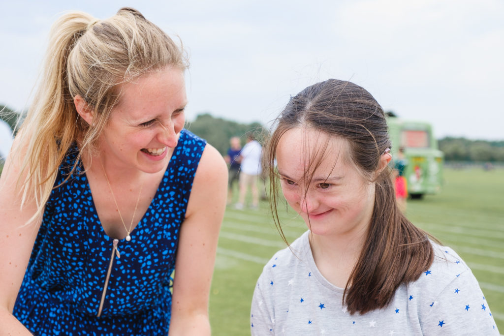 Volunteer having fun with one of the children at the Try Games 2019