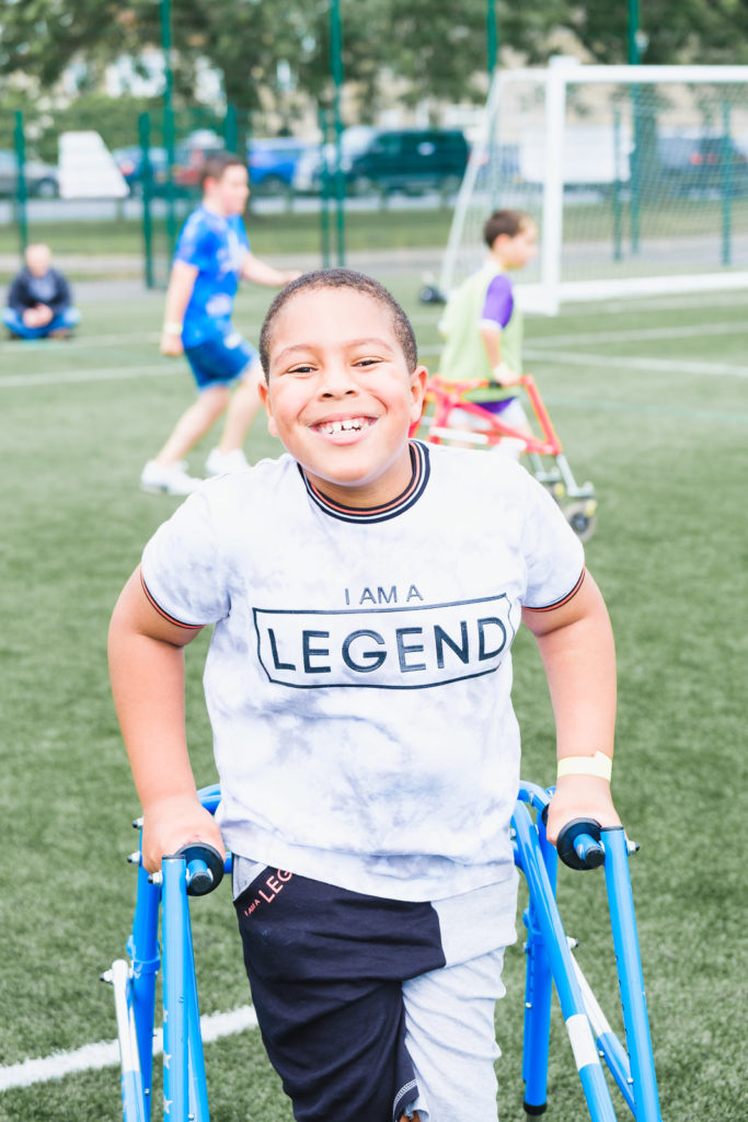 Young boy playing mobility access football at at the Try Games 2019