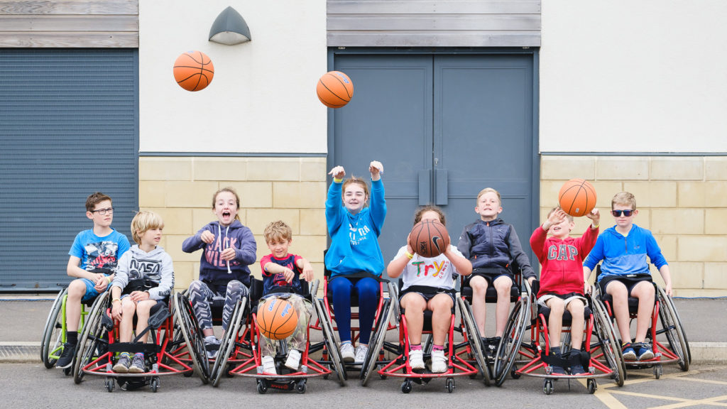 Trying out wheelchair basket ball at the Try Games 2019