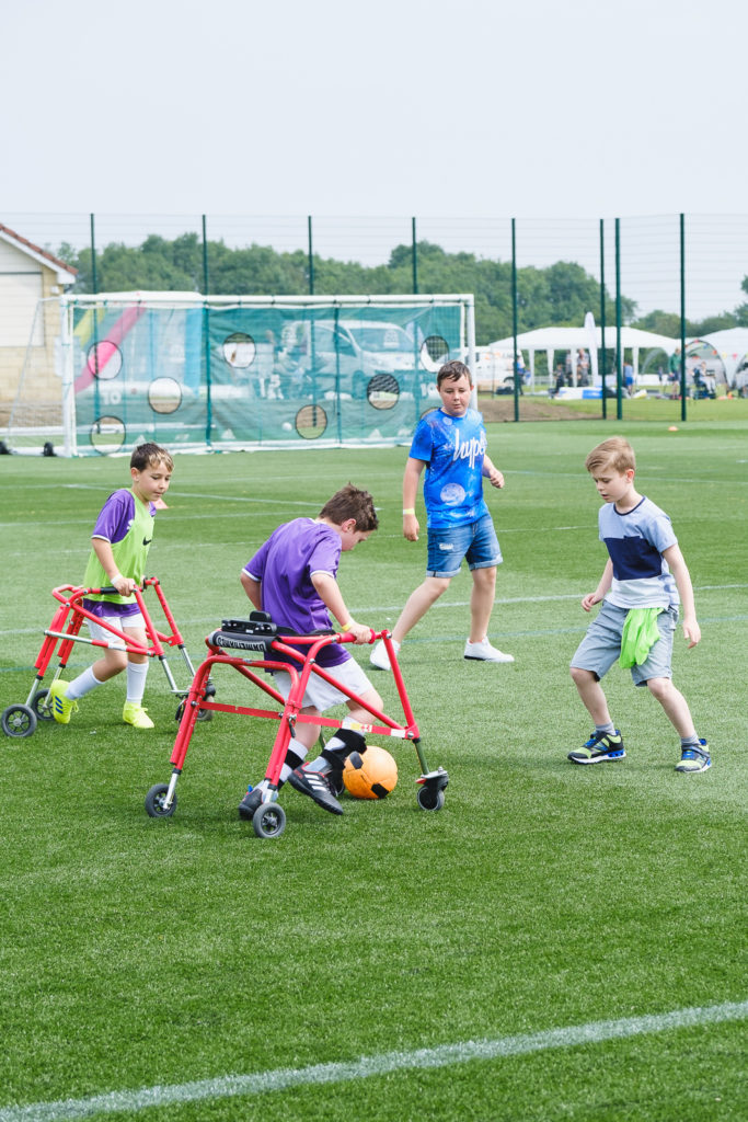 Young boys playing mobility access football at at the Try Games 2019