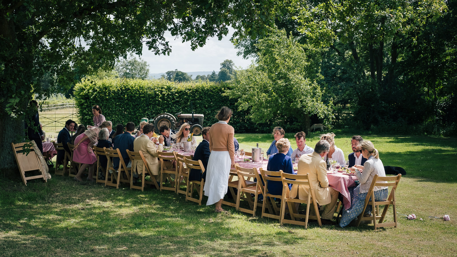 Special occasion photography with a lunch on a long table at summer garden party