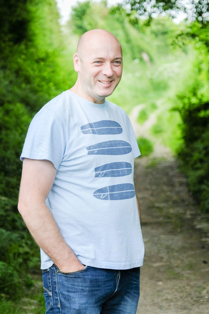 Family photography in north Wiltshire - dad smiling on summer walk with family
