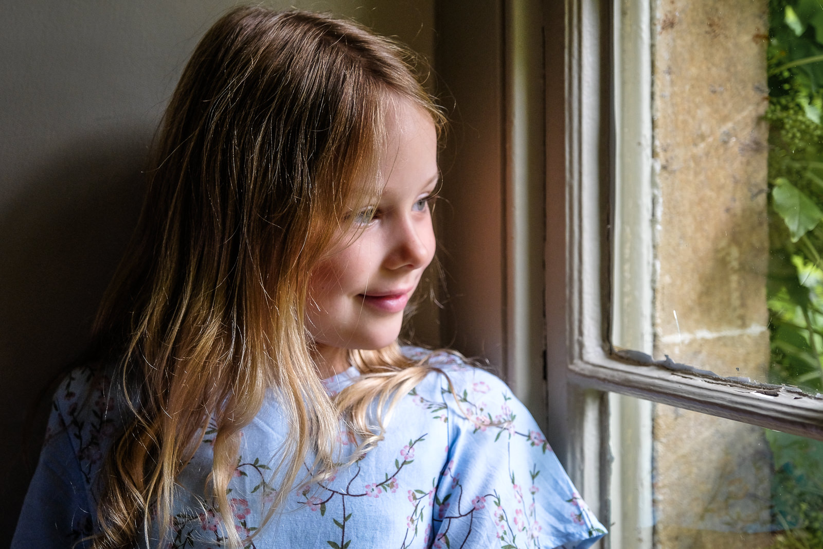 Cotswold family photo session - portrait of young girl with natural window light