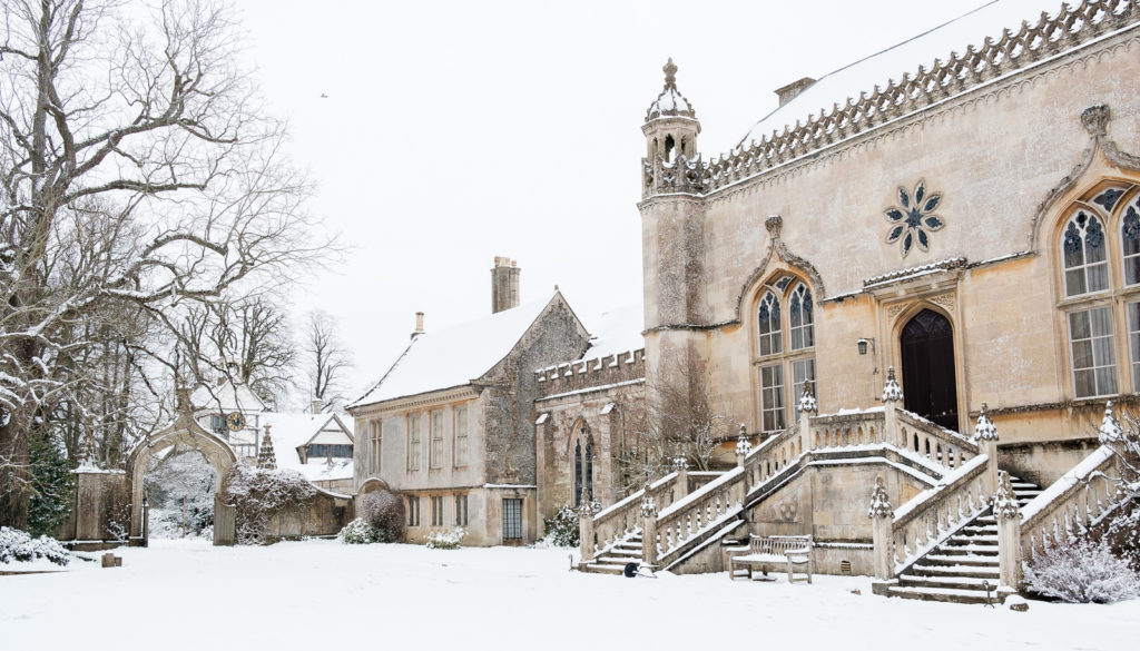 Lacock Abbey in Wiltshire with winter snow scene
