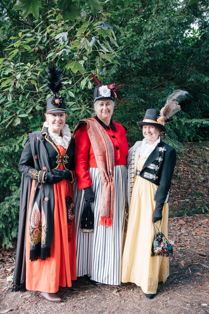 Women on holiday in traditional costume at the Jane austin Parade in Bath