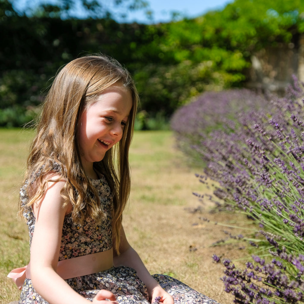 Young girl with fresh lavender in Cotswold country garden