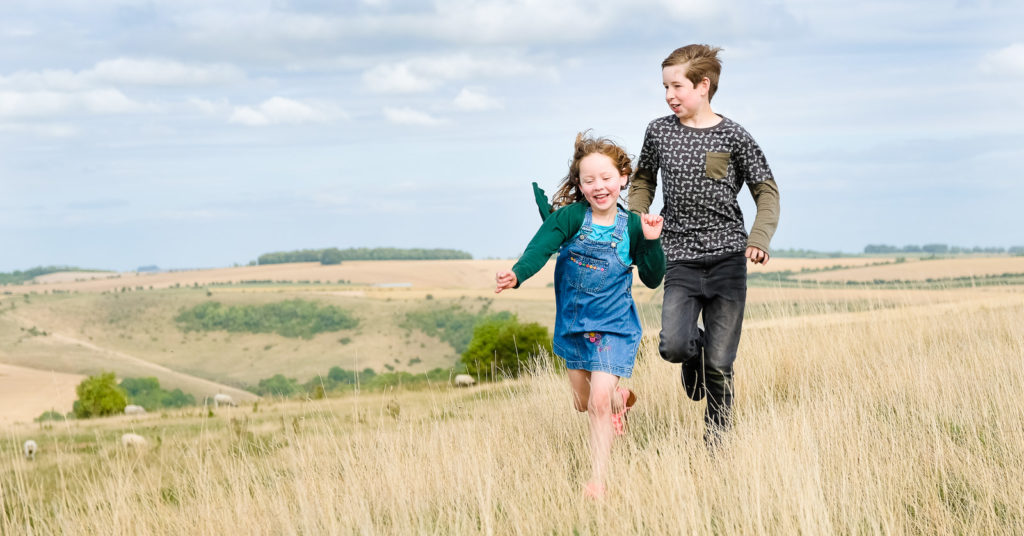 Brother and sister enjoying wide open spaces at the Westbury White Horse