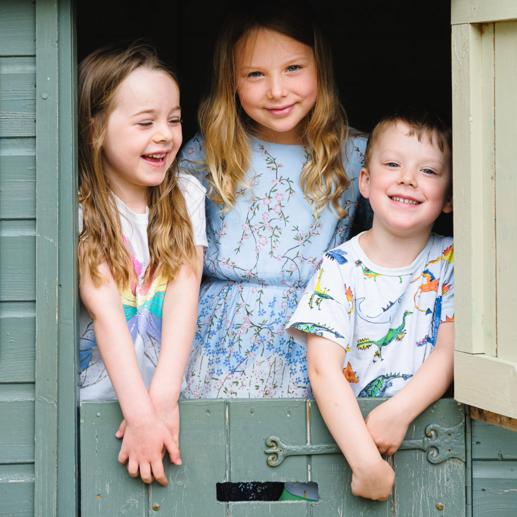 Family photo session with young children in the summer house at their Cotswold holiday home