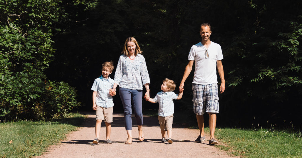 Family of four enjoying a walk at Westonbirt Arboretum in teh Cotswolds