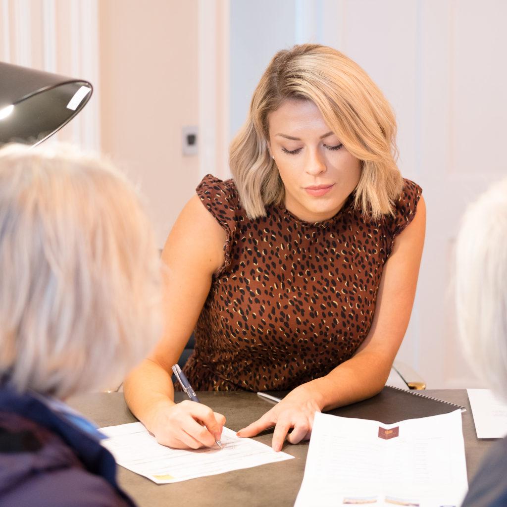 Sales team taking client details at Bath property launch