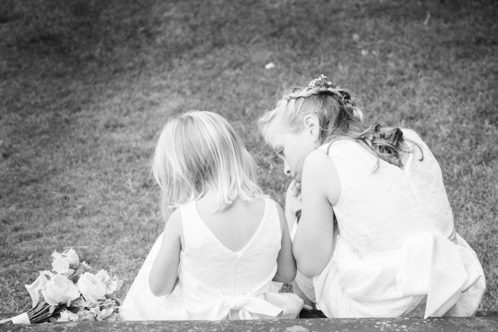 Young bridesmaids taking a break at summer wedding